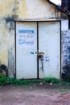 Ads and Locks - An ad is found on a locked door in Kochi, India