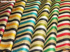 TAFFETTA FABRIC A gorgeous finished silk, often iridescent...always perfect!! Taffetta fabric in multicolored stripes.... available @  Suseelk!!