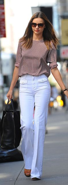 An Expert's Guide to Finding the Perfect White Jeans: 5 tips for finding white denim for Summer and beyond. Miranda Kerr wearing trouser-fit wide-legged white high-waisted jeans.