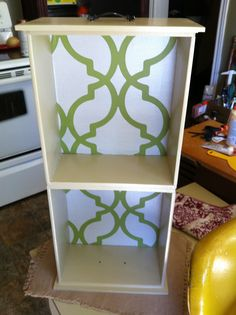shelf made from 2 wooden drawers...painted and wallpaper inside