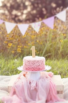 Shabby chic outdoors cake smash. So beautiful with the Black-Eyed Susans in the background!