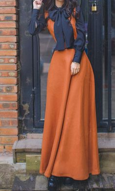 Looking for a perfect fall set? Melissa is a unique and modest set featuring a woven sleeveless maxi dress in rust and a matching navy bowknot vintage style top.