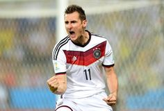 Germany's forward Miroslav Klose celebrates after scoring during a Group G football match between Germany and Ghana at the Castelao Stadium in...