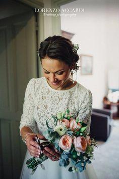 Bride smile, looking rings