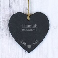 Personalise this Bride Slate Hanging Heart with one line of 12 characters and one line of 20 characters. The design features a sweet heart motif at the bottom of the slate product, with the fixed text 'Bride'. The heart has a piece of natural, rustic string which enables this item to be hung up.  PLEASE NOTE- Each slate piece will be unique as the item is cut by hand. Due to the nature of slate there will be some differences in the stone (such as texture, cut and smoothness). This may result…