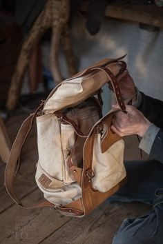 finelly organized backpack with few rollup pockets. canvas bag in a leather harn… finelly organized backpack with few rollup pockets. canvas bag in a leather harness.
