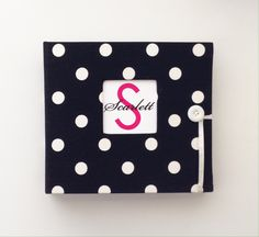 Modern baby memory books and school year albums in a baby boutique with baby products, mom gear and gifts!