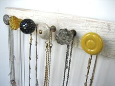 use decorative knobs for a necklace holder. brilliant, and so cute!
