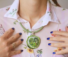 Stone necklace with a hand-painted green dragon by SkadiaArt