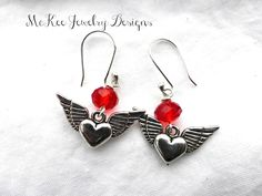 Sterling silver and red crystal heart wing earrings.