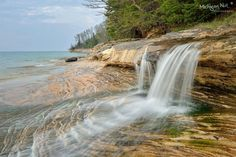 Elliot Falls is a special little waterfall located at the east end of Miners Beach, Pictured Rocks National Lakeshore. Fall In Michigan, Lake Michigan, Michigan Waterfalls, Pictured Rocks National Lakeshore, Waterfall Photo, Grand Marais, Picture Rocks, Little Falls, Fall Pictures