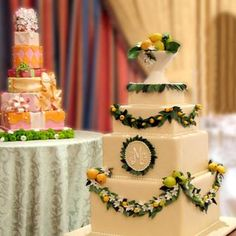 Citrus Wedding Cake with monogram - love the swags and the fruit bowl topper!