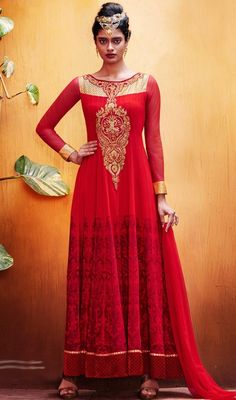 Win hearts of thy bystanders dressed in this brick red color embroidered georgette and velvet Anarkali dress. The fantastic dress creates a dramatic canvas with extraordinary lace, resham and stones work. #HotRedJewelNeckAnarkaliDress
