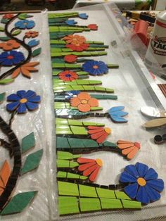 Mosaic flowers and butterfliesBeautiful exterior wall with flowers and butterflies - SalvabraniMosaic House Numbers, Palm Tree, Tropical, Bird of Paradise Flowers, in the works. Janet Dineen's Mosaic Art by HappyHomeDesignArt on EtsyVery nice Mosaic Mosaic Garden Art, Mosaic Tile Art, Mosaic Flower Pots, Mosaic Diy, Stone Mosaic, Mosaic Glass, Tile Crafts, Mosaic Crafts, Mosaic Projects