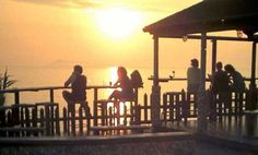 Watching the sun at a beach bar in Sidari, Corfu, Greece.
