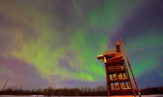 The Aurora Borealis is seen in the night sky over Joint Base Elmendorf-Richardson, Thursday, Mar. 8, 2012, above a 34-foot-tower used by United States Army Alaska (USARAK) paratroopers to practice exiting an aircraft during a parachute assault. (U.S. Air Force photo/Justin Connaher)