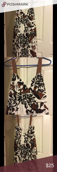 a.n.a floral dress a.n.a floral dress size 10. Very cute and comfortable! Worn only a few times. Has a place to tie in the back! I'm asking $22 or best offer! a.n.a Dresses Midi
