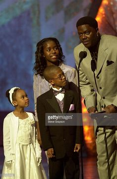 Bernie Mac (R) is joined by cast members of his self-titled show to announce winners at the 33rd NAACP Image Awards at The Universal Amphitheater in Universal City, California, February 23.