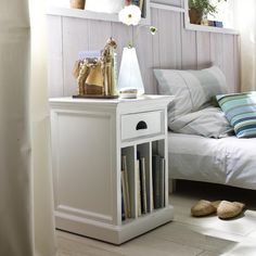 Here is a smart alternative for a bedside table. Vertical upright dividers are substituted for traditional shelving, offering a home for larger picture books, or even magazines. Crown moulding atop a drawer, and antique brass hardware completes the look. Rattan Furniture, White Furniture, Living Room Furniture, Hygge Home, Living Room Grey, Wall Treatments, Home Decor Trends, Decoration, Dekoration