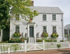A beautiful Fair Street home ready for the summer season. Banquet Seating, Large Laundry Rooms, Nantucket Island, White Picket Fence, Pine Floors, Built In Bookcase, Rose Cottage, Stairways, Real Estate