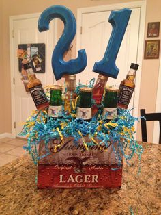 21st birthday idea for guys. Favorite drinks and color scheme