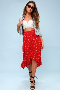 Take the Billabong Dancing Til Dawn Red Floral Print Midi Wrap Skirt from the beach to salsa in the streets! Gauzy floral print woven fabric falls from a high-waist, into a wrap silhouette with adjustable waist tie and an asymmetrical, ruffled midi hem. Metal logo tag at back.
