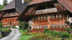 Emmentaler style houses   Eggiwil, Switzerland Alpine Chalet, Swiss Chalet, Winterthur, Wakeboarding, Zermatt, Switzerland House, Places Around The World, Around The Worlds, Swiss House