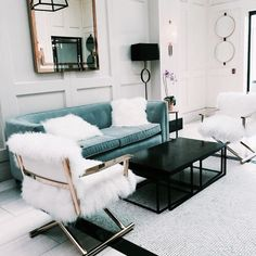 I find this to be scrumptious: the white panelled walls, the plush aqua tufted couch, the fluffy additions, the black accents... I. can't. even.