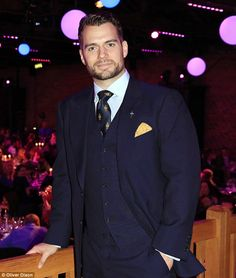Looking good:Impeccably dressed in a midnight blue three-piece suit complete with a gold pocket square, the actor, 32, displayed his handsome looks as he relaxed on the celebratory evening