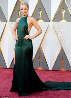 Emerald gown: Rachel McAdams wore a revealing emerald gown on Sunday to the Academy Awards in LA