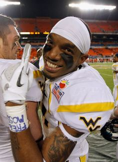 MIAMI GARDENS, FL - JANUARY 04:  J.D. Woods #81 of the West Virginia Mountaineers celebrates West Virginia's 70-33 win against the Clemson Tigers during the Discover Orange Bowl at Sun Life Stadium on January 4, 2012 in Miami Gardens, Florida.  (Photo by Streeter Lecka/Getty Images)