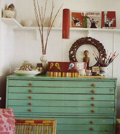 Exquisite turquoise chest of drawers.