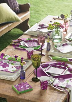 My Paper Shop.com - Purple Floral Party Supplies feature an array of pretty flower blooms printed in shades of plum and lavender. This elegant design is printed on the following tableware items: Paper Napkins,  Guest Hand Towels , Paper Plates, Beverage Cups,  Plastic Table Covers , and Party Invitations. Complete the look by using our solid colored  Lime Green  tableware. All items are poly packaged and bar-coded for retail opportunities. Our Purple Floral ensemble will add a contemporary…