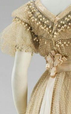 Close up of a dotted swiss lily of the valley dress