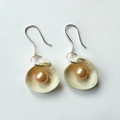 These sea shell earrings are super easy to make and they turn out really cute!