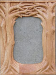 Mirror frame of interwoven trees carved in limewood