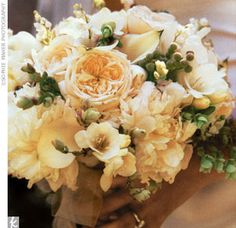 A fragrant bouquet in green and white: peonies, calla lilies, lily of the valley, and eucalyptus seed.