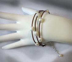 Leather Pearl Bracelet Freshwater Pearl Adjustable Brown or | Etsy Leather Pearl Bracelet, Leather Charm Bracelets, Leather Cord, White Freshwater Pearl, Matching Necklaces, Natural Leather, Fresh Water, Pearls, Brown