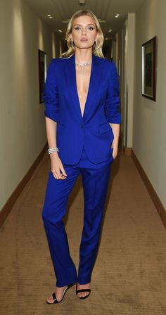 Lily Donaldson mastered the wedding guest dress code with her cobalt blue, sharply tailored suit. Though you might need to invest in a lot of tape to go commando up top like Lily has.