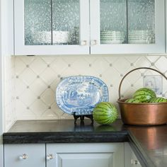 Light blue accents give this white kitchen backsplash a classic look. More kitchen backsplashes: http://www.bhg.com/kitchen/backsplash/backsplash-pairings/?socsrc=bhgpin080312vintageblueandwhitetile#page=4