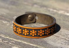 Items similar to leather bracelets,carved leather bangle for women, womens leather bracelet,daisy bracelet for women on Etsy Leather Bracelets, Leather Necklace, Leather Jewelry, Bracelets For Men, Fashion Bracelets, Daisy Bracelet, Leather Flowers, Women Jewelry, Hdr