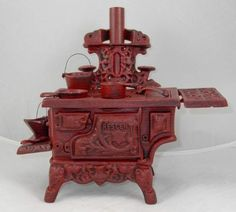Very detailed Reproduction old style cooking stove. Many parts and some assembly required. Ideal decorative piece for any decor or space. Available in 2 colors Black or Red Size: Inches to top . Pretend Play Kitchen, Play Kitchen Sets, Toy Kitchen, Kitchen Playsets, Swag Curtains, Coupons By Mail, Cooking Stove, 2 Colours, Cast Iron