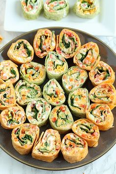 Colorful and delicious, Veggie Tortilla Pinwheels Appetizer is easy to make for tailgating. These small bites are the perfect healthy appetizer! appetizers for potluck Veggie Pinwheels Party Appetizer with Ranch Cream Cheese Spread Tortilla Pinwheel Appetizers, Tortilla Pinwheels, Pinwheel Recipes, Healthy Pinwheels, Tortilla Rolls, Pinwheel Wraps, Turkey Pinwheels, Healthy Appetizers, Appetizers For Party