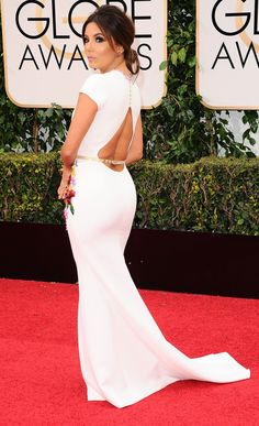 EVA LONGORIA -EVA LONGORIA in a white dress with beaded floral accents and covered buttons, plus a belt over the cutout back and Lorraine Schwartz ruby earrings.
