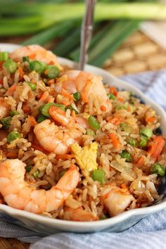 Here's an Easy Shrimp Fried Rice Recipe. This is a classic Asian fried rice recipe that is easy to make and is a website favorite. Easy Shrimp Fried Rice Recipe, Chinese Shrimp Fried Rice, Shrimp And Rice Recipes, Easy Fried Rice, Salmon Fried Rice, Seafood Rice Recipe, Seafood Fried Rice, Healthy Fried Rice, Thai Fried Rice