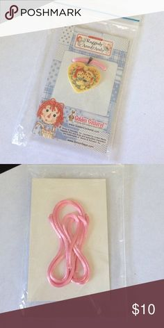 Raggedy Ann & Andy Necklace/Choker Adorable Raggedy Ann & Andy item! Brand New! Never Opened! Raggedy Ann & Andy Jewelry Necklaces