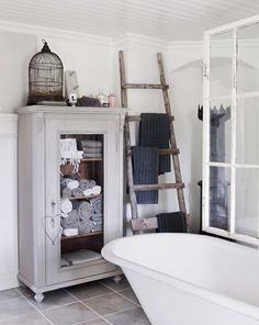 Hang your towels on a rustic ladder.