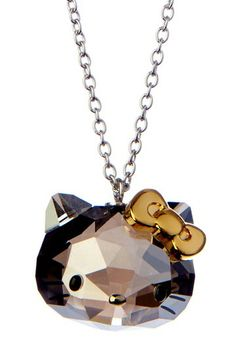 "Hello Kitty Satin Crystal Pendant Necklace by Swarovski  - Gold bow and satin crystal Hello Kitty pendant on a rhodium chain necklace - Lobster clasp - Approx. 16.5"" chain length with 1.75"" extension - Approx. 0.62"" L x 0.75"" W pendant - Imported Materials Gold, rhodium, Swarovski crystal $150"