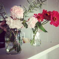 flowers arranged in Mason Jars
