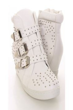 Be comfy yet stylish this season with these fashionable sneaker wedges! Make sure you add these to your closet, it definitely is a must have! The features include a faux leather upper with studded detailing, front strap design with high polish metal buckles, round closed toe, stitched detailing, side zipper closure, smooth lining, and cushioned footbed. Approximately 3 inch hidden wedge heels.